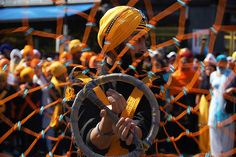 Chakaram    Here is a close up action shot of a Sikh performing Gatka with a chakram a throwing weapon from India. The word chakram comes from the Sanskrit term chakra, meaning circle or wheel.