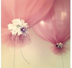 Satin balloons wrapped in tulle and tied with flowers and string..