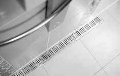 Bathroom - shower with linear floor drain. Grating and frame in brushed stainless steel. Unidrain®: ClassicLine