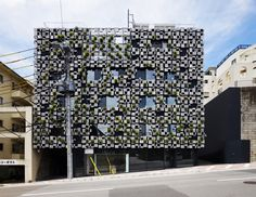 Green Cast by Kuma Kengo  The façade of the building is covered with planters made of aluminum die-cast panels, which provides space for facilities. The 3 (up to 6) aluminum panels, which also form planters, are made in monoblock casting. Each panel is slanted, and its surface appears to be organic, of which cast comes from decayed styrene foam.