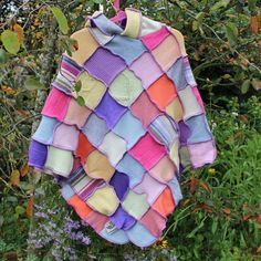 Upcycled patchwork poncho with a pointy pixie hood. Made from recycled wool knitwear  For age 6-8 approx