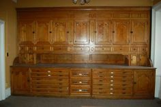 """1880's ash and oak vestment cabinet at a salvage sale for the Archdiocese of St. Cloud. It is GIGANTIC, 15' wide, 9'3"""" tall and more than 4' deep."""