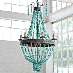 "Regina Andrew Lighting Turquoise Beaded Chandelier - Draped strands of turquoise stones, distressed metal & natural elements form a traditional shape creating a unique showpiece in an entryway, dining room or living space. Light fixture includes canopy & 39"" of chain. Uses eight 40W max type B bulbs. Measures 27""Dia. x 46""H -- $1,698.00"