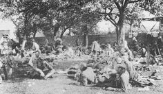 Rest on the retreat from Mons. 11 am 25 August, 1914, and the men of the 1st Battalion Cameronians have been walking since 3 am when they left Mons. A German plane had been observing them since daylight and an officer is now watching it observe their rest.