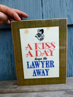 A Kiss A Day Keeps The Lawyer Away funny sign for by OatesGeneral