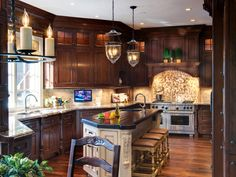 As part of a major home renovation, this beautiful kitchen was enlarged by utilizing an adjacent existing laundry room. Cherry cabinets that have been antiqued and glazed for an Old World look surround a dark-topped island lit by overhead pendant lighting.
