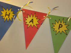 super hero birthday banner made with curly ribbon and printed out in Word - no gluing required!