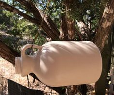 Maple Syrup Jug Birdhouse : Make a cute little birdhouse from recycled Maple Syrup Jug or any sturdy used jug container. Maple Syrup Bottles, Bird House Feeder, Bird House Plans, Reuse Recycle, Bottle Crafts, Household Items, Bird Houses, Painted Furniture, Diy Projects