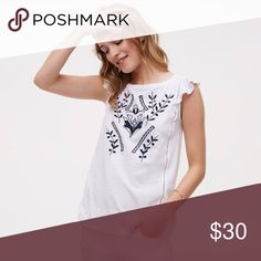 Embroidered Ruffle Sleeve Top Intricate floral embroidery  and cutout trim sweeps this fluttery cotton piece off its feet. It has a round neck finish and fluttery cap sleeves. This soft and airy top is great for a hot day, easy to dress up or down. LOFT Tops