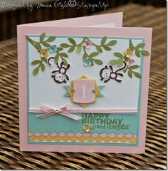 Very lovely design-check out the thin ribbon and layered tag!  By: Monica Gail 1st hb