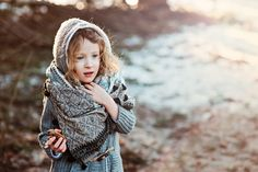 adorable romantic child girl walking in early spring forest