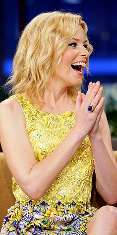 Elizabeth Banks makes her statement gem work with a busy ensemble by picking a ring (this one is House of Lavande) that pulls from the same rich cornflower blue in her skirt, meaning it coordinates instead of competes with her ensemble.