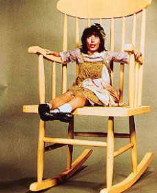Lily Tomlin as Edith Ann  .... this also makes me think of the telephone operator ... can't remember her name in that...I loved it!