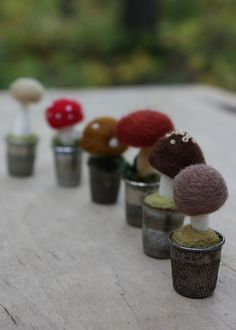 Tiny toadstools in vintage thimbles.  Little needle-felted pieces I've recently completed.  Made entirely of wool.  These are on their way to the Walker Art Center shop.  If you see them there, give them a wave for me.