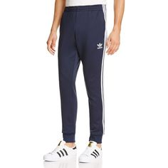 Adidas Originals Superstar Track Pants ($65) ❤ liked on Polyvore featuring men's fashion, men's clothing, men's activewear, men's activewear pants and navy
