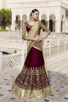 ETHNIC GRANDEUR 5046 Velvet Lehenga Saree Come In Its Most Traditional Colour Of Maroon Alongwith Beige Net Pallu. Blouse Also Come In Velvet Fabric With Sleeve In Jersey Fabric. Kalis And Blouse Embroidery In Zari Alongwid Handwork Is The Highlighting Feature. Buy Now:- http://eshop.nakkashi.in/ethnic-grandeur-5046.html