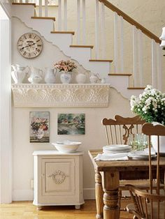 LOVELY Decorating Idea for a Wall by Stairs .... love it