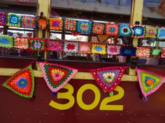 Tram 302 in Bendigo has been yarn bombed again it's same ,same but different with new pompoms and more flowers.