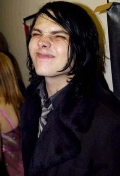 Backstage: KROQ Almost Acoustic Christmas Show in Universal City, LA, California, on 12 December 2004. Gerard Way, making faces.