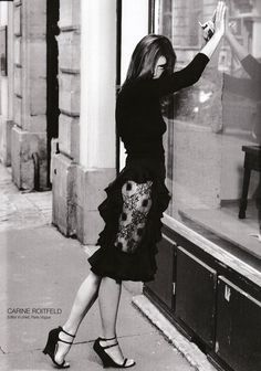 Carine Roitfeld in a YSL by Tom Ford skirt with side lace panels and ruffles.