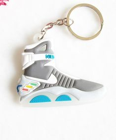 new styles 72d7f 8ab28 Details about Mini Silicone Back To The Future II Glow In The Dark Air Mag  Keychain Kids