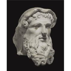 A MARBLE HERM HEAD OF HERMES, ROMAN IMPERIAL, CIRCA 2ND HALF OF THE 1ST CENTURY A.D.  with long moustache and forward-projecting beard of thick corkscrew curls, parted lips, and eyes drilled in the inner corners, his wavy hair falling over the forehead and nape of the neck and bound in a wide undulating fillet; mounted on a marble bust perhaps ancient but recut in modern times, the later socle engraved with the name Quirinus.