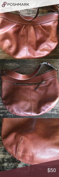 """Coach shoulder bag Beautiful brown leather coach purse. This has been very loved. There is wear shown in pictures. Inside has some pen marks but otherwise very good condition. Zipper pocket on outside. Zipper and 2 slip pockets on inside.  Measurements from the top 16x12 10"""" strap drop. Coach Bags Hobos"""