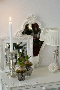 A quick and easy Christmas decoration using layered mirrors, mercury silver candle sticks and greens from bulb flowers. See more details at http://www.songbirdblog.com