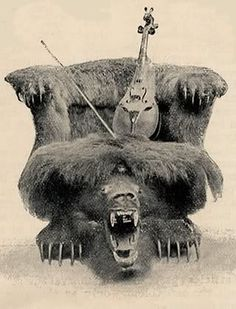 A view from the front of the chair.  By touching a cord, the head of the monster grizzly bear with jaws extended, would dart out in front from under the seat, snapping and gnashing its teeth.