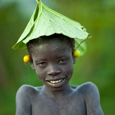 Shy surma boy in Turgit - Ethiopia by Eric Lafforgue, via Flickr
