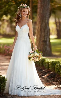 Stella York #6282 - This sexy lace wedding dress from Stella York is lighter than air with chiffon and corded lace to make your walk down to aisle dreamy. Sexy spaghetti straps and a sweetheart neckline frame the face.
