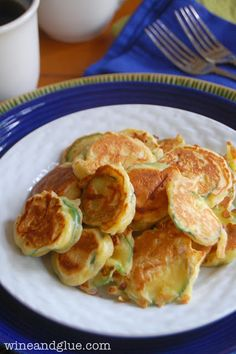 Zucchini Fritters, the perfect breakfast to share, so delicious they might not make it to the table via www.wineandglue.com
