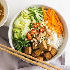 Vietnamese noodle salad with rice vermicelli fresh herbs and chili tossed together with a tangy dressing topped with crispy tofu. Spicy Thai Noodles, Pork Noodles, Beef Back Ribs, Beef Ribs, Pho Noodle Soup, Noodle Bowls, Thai Dipping Sauce, Vietnamese Noodle Salad, Salad Rolls
