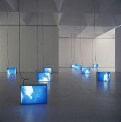 designcloud:    Promised Land by Information Fiction Publicité, 1992  Set of 10 aluminum light boxes, fluorescent tubes, duratrans, methacrylate - 72 × 96 × 18cm each