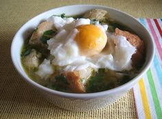 A delicious typical Portuguese dish, very simple to prepare, soup with poached eggs and slices of crusty bread, seasoned with olive oil, garlics, pepper and a little salt.