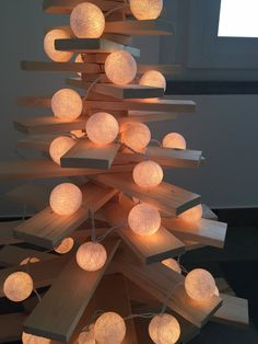 A CHRISTMAS TREE thought to hang and to support the decorations, composed by strips of poplar wood with natural finish