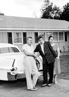 Elvis, Vernon, and Gladys Presley with Elvis's 56 Cadillac Eldorado Convert in front of their pre-Graceland home on Audubon Drive in 1956.