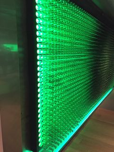 Heineken bottles making a wall with lighting element behind which moves to dim and light the bottles, Amsterdam