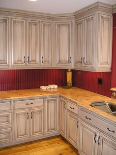 taupe with brown glazed kitchen cabinets - I think we could easily update your cabinets w some glaze.