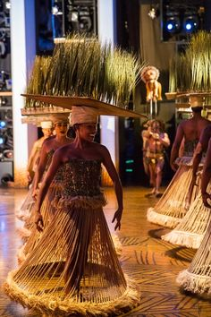 I would love to figure out how to do these headpieces. Maybe Carolyn can help me with this. Grass hula skirts from anywhere.
