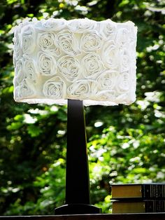 how to pretty up an old garage sale lampshade with a sheet and some spray paint. gorgeous.