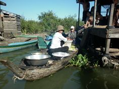 Floating Village outside Pursat, Cambodia.  Food delivery