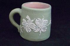 PISGAH FOREST POTTERY CAMEO DOGWOOD MUG 1951 Artist signed SLA.  Sarah Louis Brown Austin. She developed her own cameo designs and signed them SLA.