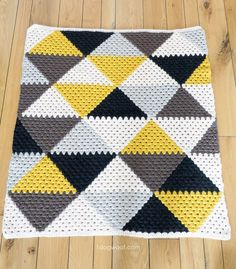 Modern geometric baby afghan using traditional granny stripes.