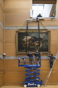 """""""Installation team removing a George Stubbs painting from the Yale Center for British Art Library Court prior to construction, photograph by Richard Caspole."""" (britishart.yale.edu)"""