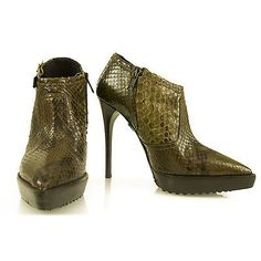 Burberry Snake Skin Leather Ankle Booties Boots, shoes size 37These chic and elegant Burberry Stiletto heel Booties are a bold and impressive addition to any wardrobe! These ankle boots feature green luxurious  snake skin leather, high heels, side zipper, buckle embellishments and pointed toes. The lightly padded insoles are lined with leather and stamped with logo. This is a unique style any fashionista would not want to miss! Always in fashion with this stylish pair!Brand: BurberryColor…