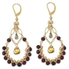 Divine Hoop Earrings with Garnet -- These flattering, flirty earrings are made of  garnets woven together with dainty gold filled chain and frosted rounds, finished with labradorite & whisky quartz  briolettes,  on gold filled lever backs.  Approximately 1 & 1/2 inches wide and 2 & 3/8 inches long from the bottom of the lever back ( 2 & 7/8 inches long when measured from the top of the lever back.