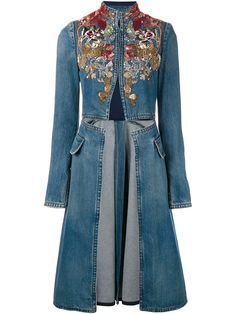 This blue Alexander McQueen embellished denim coat is a distinctive piece from the eponymous label's lauded new season collection. Typical of the brand's experimental and romantic aesthetic, this precise Italian design has been fabricated from cotton and features a high collar, cutout waist and a striking multi-coloured embroidered and embellished yoke. Complete with long sleeves and two front pockets, wear this statement-making coat with a white ruffle short and tailored trousers for a…