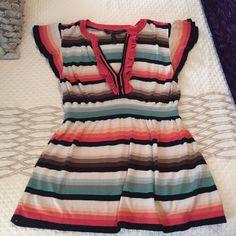 BCBG MaxAzria ruffle blouse size M BCBG MaxAzria beautiful striped ruffle blouse. Cap sleeves, v-neck, fits loosely around torso. size M, like new! BCBGMaxAzria Tops Blouses