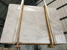 United Stone is a marble slabs wholesaler, stone projects builder and marble quarry owner in China. Marble Suppliers, Gray Background, White Marble, Shades Of Grey, Surface, Mirror, Stone, Cool Stuff, Home Decor